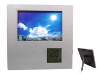 Porta retrato para brindes com relógio digital Tamanho da foto: 12 x 9 cm.