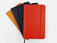 Caderneta com capa em couro sintético e folhas pautadas